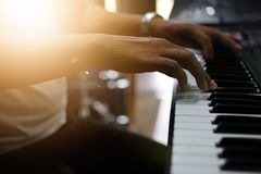 Male hands, musicians are playing the piano. stock photos