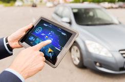 Male hands with navigator on tablet pc and car Royalty Free Stock Photography
