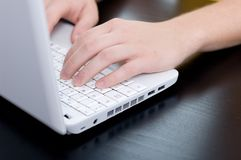 Male hands on a notebook keyboard Stock Image
