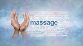 Male massage hands word cloud. Male hands open and reaching upwards on a light blue stone effect background with white wispy smoke trail and a massage word cloud Stock Image