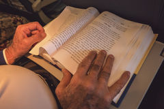 Male hands and opened book. Stock Photos