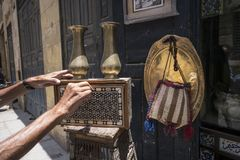 Male hands opening an antique backgammon board in Cairo Royalty Free Stock Image