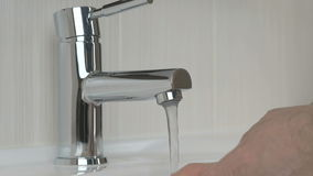 Male hands opening chrome-plated tap stock footage