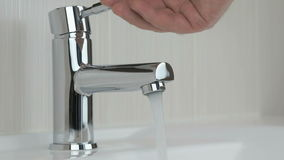 Male hands opening chrome-plated tap stock video