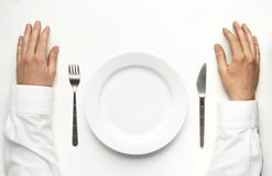 Male hands over the table waiting for dinner. Royalty Free Stock Image
