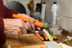 Male hands peel vegetables Stock Images