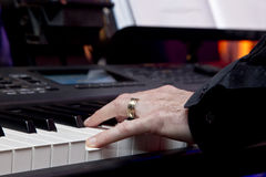Male hands on a piano Royalty Free Stock Photos