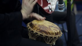 Male hands play a on the African drum. Close-up stock video