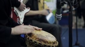 Male hands play a on the African drum. Close-up stock footage