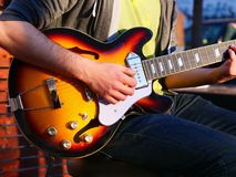 Male hands play an electric guitar royalty free stock images