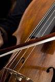 Male hands playing cello. Male hands playing old cello Royalty Free Stock Photo