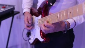 Male hands playing on electric guitar close up. stock video footage