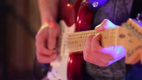 Male hands playing on electric guitar close up. Playinf by mediator solo rock song. stock video footage