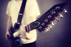Male hands playing electric guitar Stock Photos