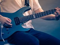 Male hands playing electric guitar. Male hands with electric guitar. Close up, part body adult person is holding instrument and playing. Hobby, music concept stock photos