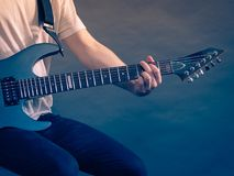 Male hands playing electric guitar. Male hands with electric guitar. Close up, part body adult person is holding instrument and playing. Hobby, music concept royalty free stock photos