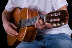 Male hands playing guitar Royalty Free Stock Photo