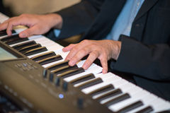 Male hands playing the piano Royalty Free Stock Image