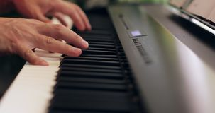 Male hands playing the piano. Close-up. stock video