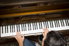 Male hands playing piano indoors Royalty Free Stock Photography
