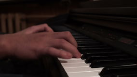 Male hands playing piano. Musical concert piano. Keyboard instrument. Male hands playing piano. Musical concert piano. Close up male hand musician playing piano stock video footage