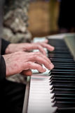 Male hands playing the piano, press the keys, music concept Stock Photo