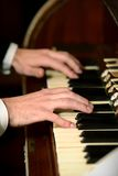 Male hands playing on piano. Two male hands playing on piano keys Stock Image