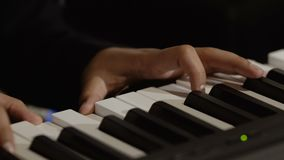 Male hands plays melody on piano stock footage