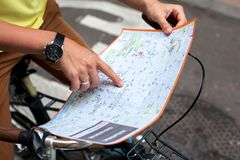 Male hands pointing on the map of Barcelona city on retro bicycle bike background.Tourism concept. Vacation.Holiday. Male hands pointing on the map of Barcelona Royalty Free Stock Images
