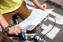 Male hands pointing on the map of Barcelona city on retro bicycle bike background.Tourism concept. Vacation.Holiday. Male hands pointing on the map of Barcelona Stock Image