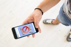 Male hands pop up ads blocker smartphone. Closeup of male hand using smartphone ads blocker Stock Image