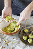 Male hands preparing homemade falafel with chickpeas flour on rustic table Royalty Free Stock Photo