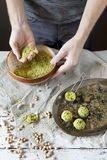 Male hands preparing homemade falafel with chickpeas flour on rustic table Royalty Free Stock Photography