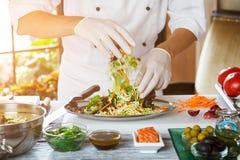 Male hands preparing salad. Royalty Free Stock Image