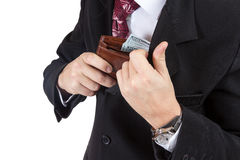 Male hands put the purse in his pocket Royalty Free Stock Photos