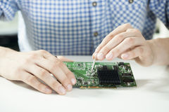 Male hands repairing computer hardware Stock Photos