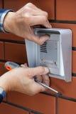 Male hands repairing intercom Stock Image