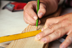 Male hands with ruler and pencil closeup. Royalty Free Stock Images