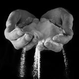 Male hands with salt pouring through Stock Photos