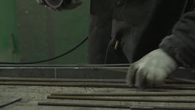 Male Hands Sawing Off Iron Rods Using A Metal Saw stock video footage