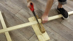 Male hands sawing wood, home improvement conception stock video