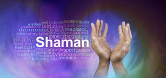 Male Hands Shaman word cloud banner. Male hands reaching up with the word SHAMAN beside surrounded by a word cloud on a wide gaseous ethereal energy background stock photography