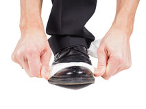 Male hands shining black leather shoes Royalty Free Stock Photo