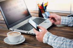 Male Hands Shopping On Laptop With Credit Card. On Rustic Wooden Table In Office Royalty Free Stock Photo