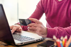 Male Hands Shopping Online With Credit Card. Male Hands Shopping On Internet With Credit Card Concept Royalty Free Stock Image