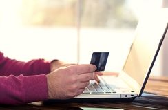 Male Hands Shopping Online With Credit Card. Male Hands Shopping On Internet With Credit Card Concept Stock Photo
