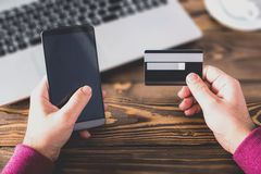 Male Hands Shopping Online With Credit Card. On Rustic Wooden Table In Office Stock Photos