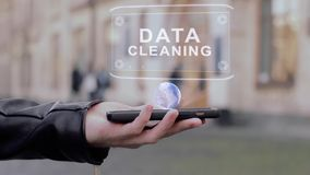 Male hands show on smartphone conceptual HUD hologram Data cleaning