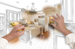 Male Hands Sketching Custom Kitchen with Photo Showing Through Stock Image