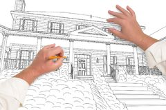 Male Hands Sketching with Pencil a Beautiful House. Male Hands Sketching with Pencil the Outline of a Beautiful House on White royalty free stock image